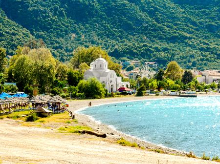 View of beach and white church in Kamena Vourla.Greece.
