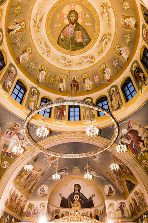 Interior of an orthodox church decorated with hagiographies