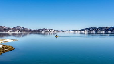 Snowy landscapes. The Lake Plastira on winter. Greece.