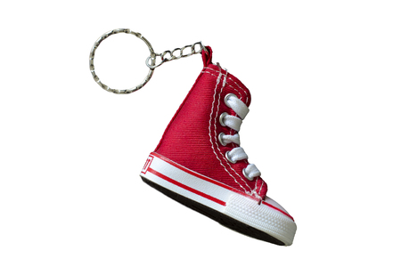 Key chain with mini red basketball shoe on white background
