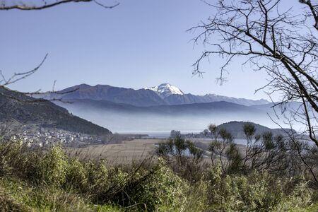 View of Pamvotis lake.Houses and fields,Ioannina city, Epirus, Greece Banco de Imagens