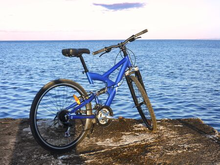 Blue mountain bike at the end of pier. Rafina city , Greece