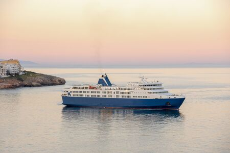 A blue white ferry boat travel from port of Rafina to aegean islands.