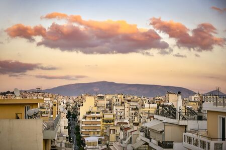 Clouds over the city of Piraeus at sunset