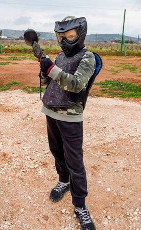 Kid is ready to play a paintball game