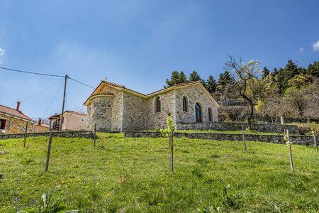 Church made of stone in Baltessiniko village, Greece.
