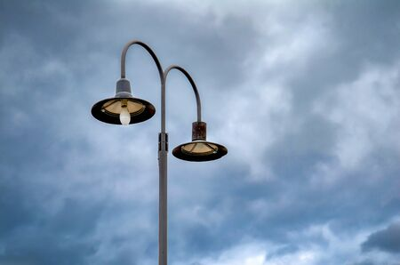 Street lamps against a dramatic blue sky Stockfoto