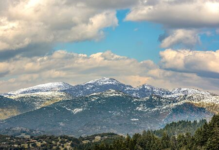 view of snow coated Helmos mountain which located in Peloponnese. Grecce.The photo taken from the opposite mountain named Mainalo