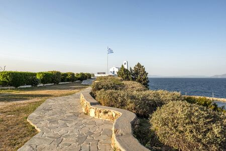 A white small orthodox chapel dedicated to St.Nikolaos. Rafina,Greece