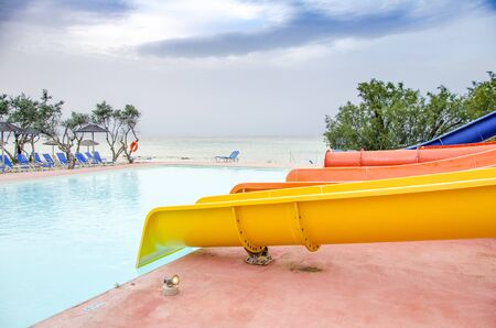 Empty colorful waterslides and pool