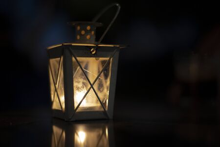 Old rustic lantern in darkness