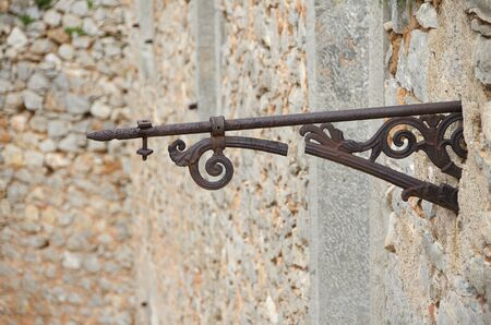Detail of rusty and broken iron on the wall