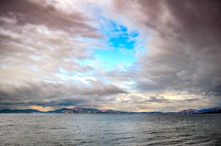 Dramatic sky over Pachi, A fishing village in Saronic gulf,Greece
