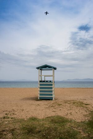 Sandy beach and lifeguard wooden tower at Rafina city.Greece