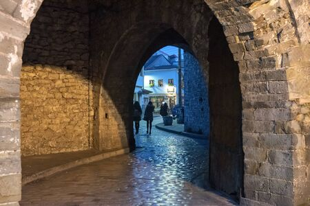 Arch entrance with stone walls to the old city of  Ioannina at night, Greece Stock Photo