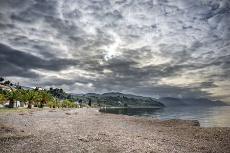 Sunset in beach in Arkitsa under a dramatic cloudscape