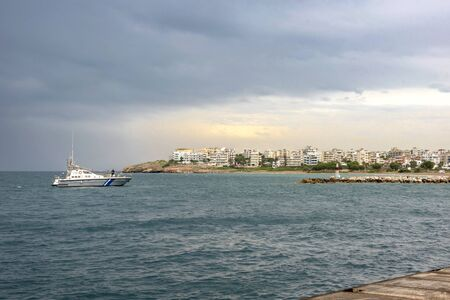 View of Rafina city under a autumnal dramatic sky