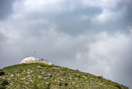 small greek orthodox chapel on top of the hill. Greek islands.