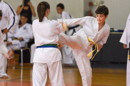 Boys and girls training in karate,tae kwvon do