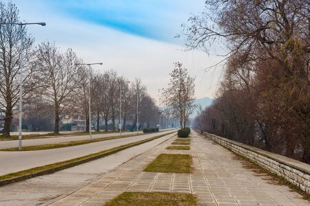 Empty streets  for cars, bikes and pedestrians in light foggy day. Ioannina. Greece