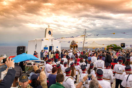 Rafina portGreece, JUNE 1 2019:many people gathered to welcome the Î'yzantine icon of Saint Nicholas in his small chapel in Rafina