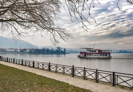 Boat on the lake Pamvotis.Ioannina,Greece Archivio Fotografico