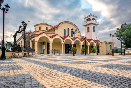 Exterior view of orthodox Christian church Analipseos Sotiros at Rafina city in Greece