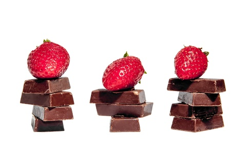 Strawberries and chocolate bars isolated photo