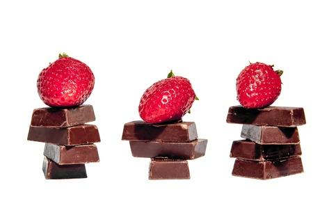 Strawberries and chocolate bars isolated photo