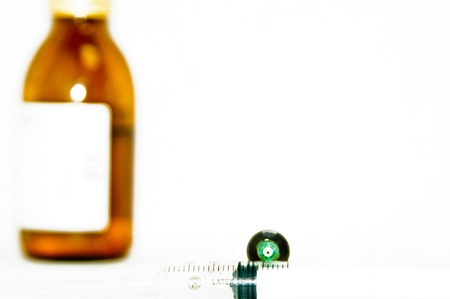 Syringe with medicine isolated photo
