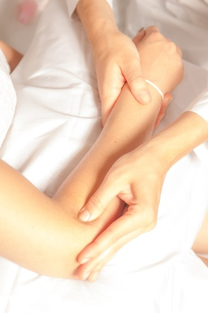 therapeutic massage: A physio gives myotherapy using trigger points on athlete woman Stock Photo