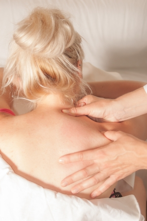 A physio gives myotherapy using trigger points on athlete woman photo