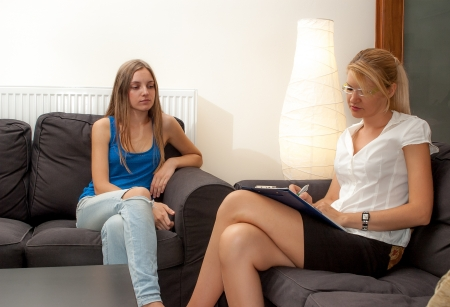 A sexy female psycotherapist treats a teenage female patient with normal and cliche ways