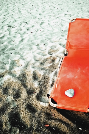 An orange sea chair at a sandy beach photo