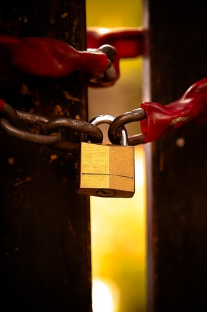 A padlock and a rusted chain
