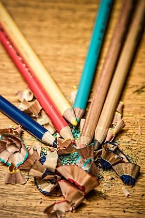 Sharpened color pencils on a wooden desk