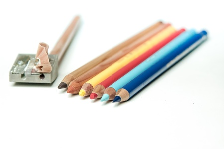 Colored pencils and sharpener isolated Stock Photo