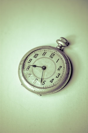 winder: Old pocket watch against a white background Stock Photo