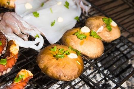 Porto bello mushrooms and sea food on barbecue, Greek cuisine Stock Photo