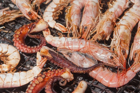 Big shrimbs and other seafood on barbecue