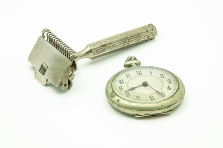 Old pocket watch and shaving device at the studio  Men accessories