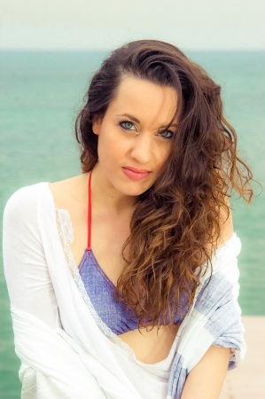 Portrait of a beautiful brunette woman at the beach Stock Photo