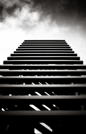 Stairs to the sky in dramatic black and white Standard-Bild