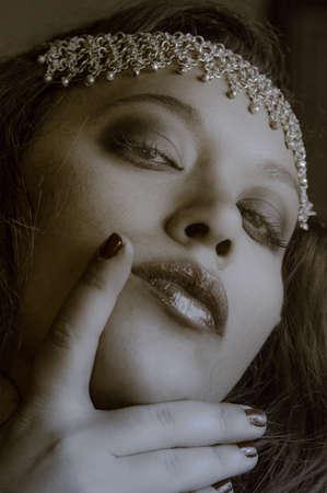 Sepia colored portrait of a beautiful multiracial girl wearing head accessory Standard-Bild