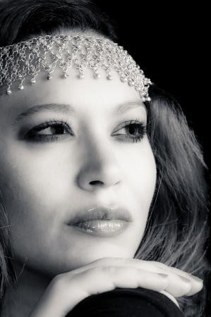 Black and white portrait of a beautiful multiracial girl wearing head accessory Standard-Bild