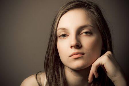 Beautiful young caucasian girl portrait in studio Standard-Bild