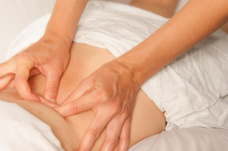 physiotherapist: A physio gives myotherapy using trigger points on athlete woman Stock Photo