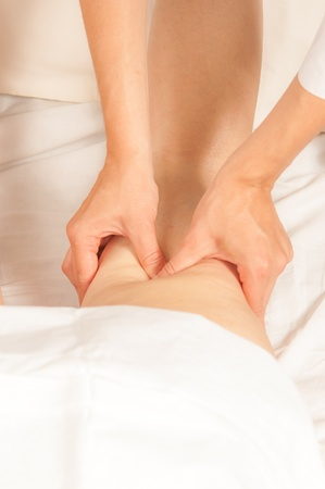 pressure massage: A physio gives myotherapy using trigger points on athlete woman Stock Photo