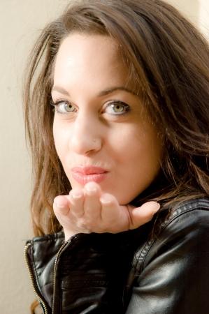 Beautiful caucasian woman sending a kiss photo