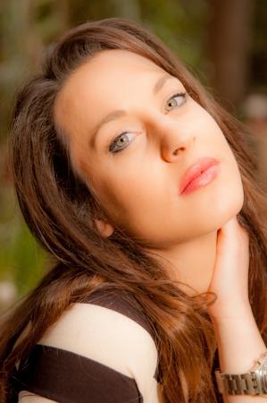 Beautiful young caucasian girl at the park